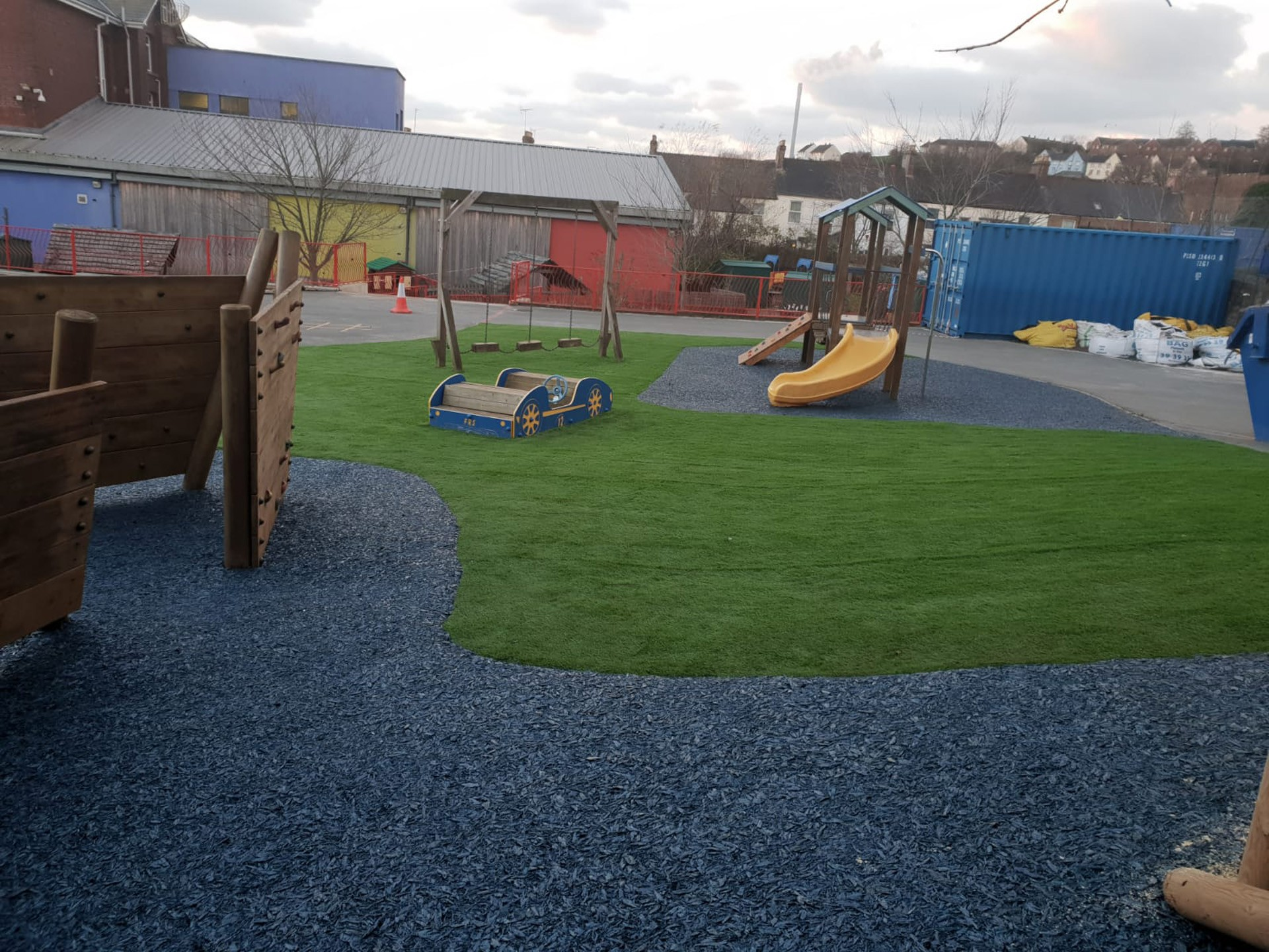 AGI Play equipment with safety mats and artificial grass