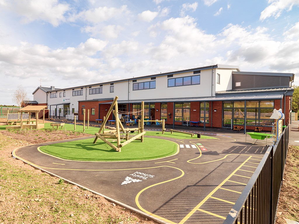 AGI Concepts - School Playground with safety surfaces and play equipment